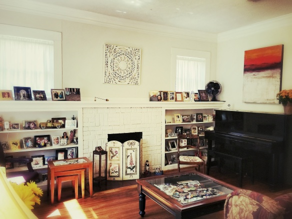 Den with original fireplace and shelving